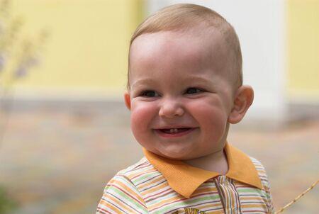 Smiling boy portrait on blurred background Stock Photo - 5495547