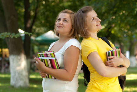 Two dreaming female students in campus park photo