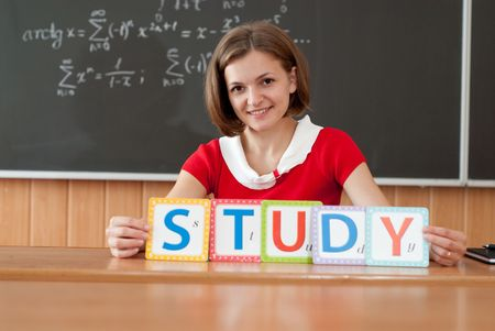 Young teacher with STUDY letters photo