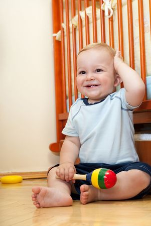 Liitle boy is sitting near his bed Stock Photo - 5620821