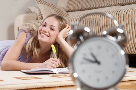Young blonde woman is studying at home Stock Photo - 5706429