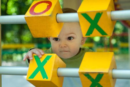 Little boy is playing tick-tack-toe on playground Stock Photo - 5807250
