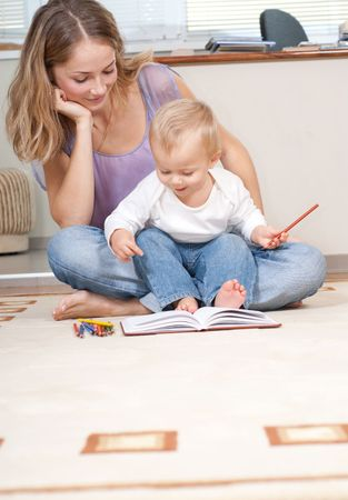 Young mother is drawing with her son Stock Photo - 5918443