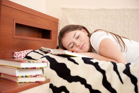 Tired female student is sleeping after long reading photo