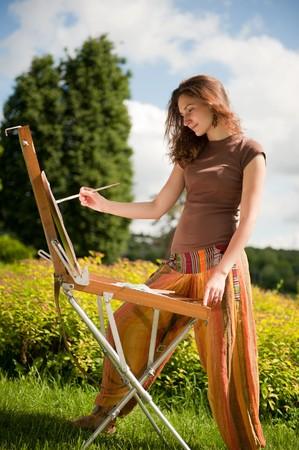 painting face: Mujer bonita es la pintura. Per�odo de sesiones de aire libre.