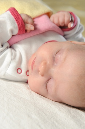 Cute little baby sleeping on white blanket Stock Photo - 8556732