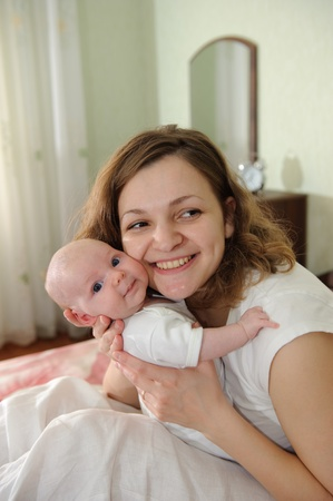 Young mother embracing her little baby Stock Photo - 8556757