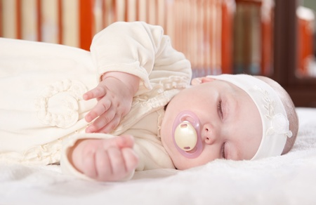 Cute baby girl is sleeping near her bed Stock Photo - 9648468