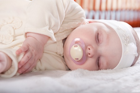 Cute baby girl is sleeping near her bed Stock Photo - 9648470