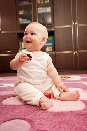 Cute baby girl s playing with toys in playroom Stock Photo - 9883980