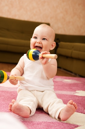 Cute baby girl s playing with toys in playroom Stock Photo - 9883957