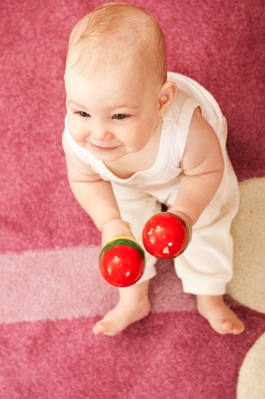Cute baby girl s playing with toys in playroom Stock Photo - 9883960