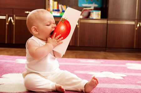 Cute baby playing wth cards and study vegetables photo