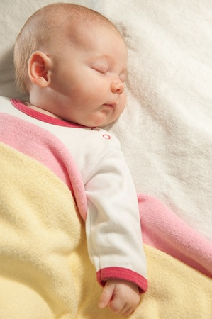 Little baby girl is sleeping at home photo