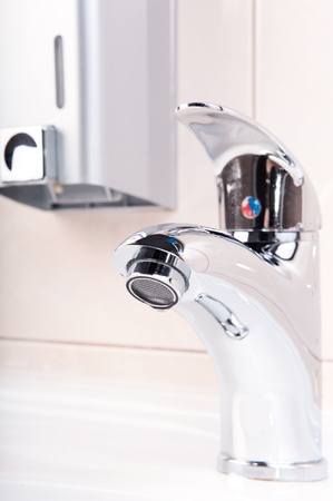 Modern metal faucet closeup. No water flowing. Stock Photo - 12611138