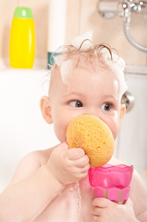 bathing beauty: Little baby girl having soapy bath at home