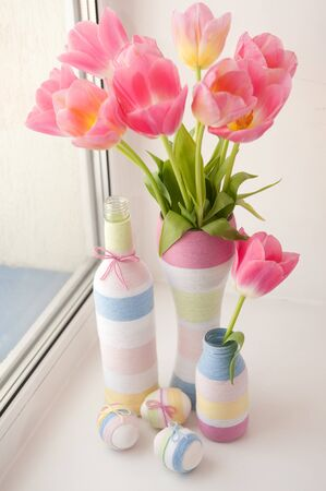 flower vase: Pink tulips in yarn wrapped vase and Eater eggs on windowsill