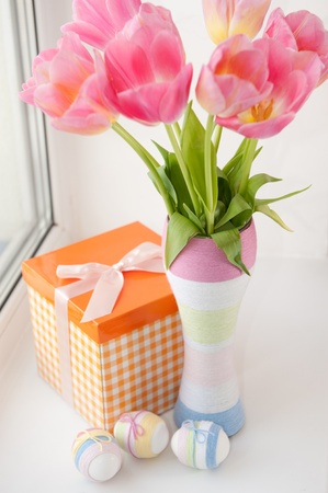 bow window: Pink tulips in yarn wrapped vase and Eater eggs on windowsill
