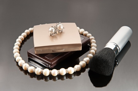 Make-up set, necklace and earrings with pearls photo