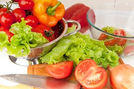 food preparation: Salad preparation of pepper, tomatoes, vegetable marrow and aubergine