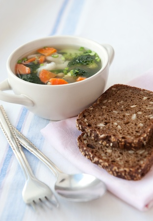 Closeup of healthy vegetable soup with wholemeal bread photo