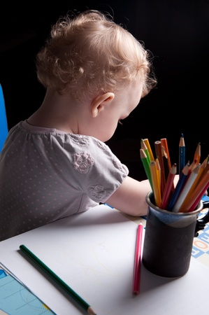 Little baby girl drawing with colorful pencils Stock Photo - 13588620