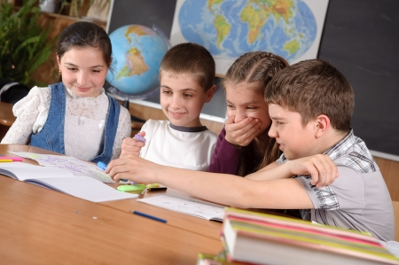 Group of pupils aged 11 study at classroom Stock Photo - 13823045