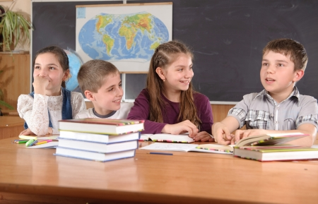 kids class: Group of pupils aged 11 study at classroom