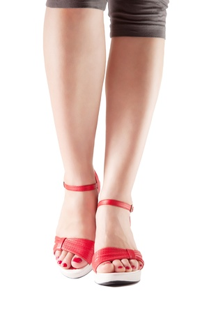 Sexy woman legs in red shoes isolated on white Stock Photo - 14153657