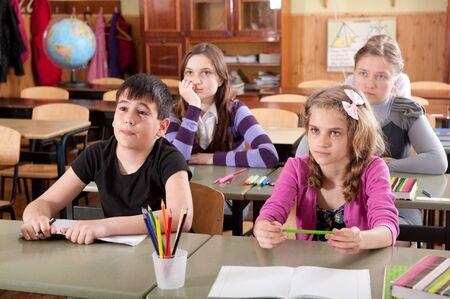 Grupo de alumnos en clase durante una lección Foto de archivo - 14469127