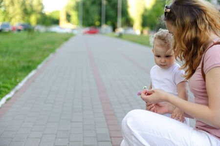 Young mother and her daughter on a paved street Stock Photo - 14468807