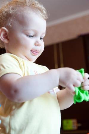 geen: Cute baby girl modeling with geen clay