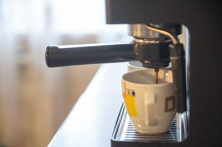 Coffee making using espresso machine at home Stock Photo - 14565288