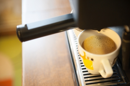 Coffee making using espresso machine at home Stock Photo - 14565911