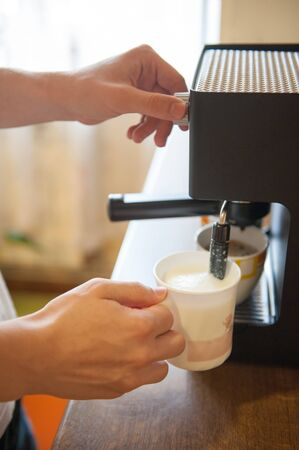 Whipping milk with espresso machine at home Stock Photo - 14565922