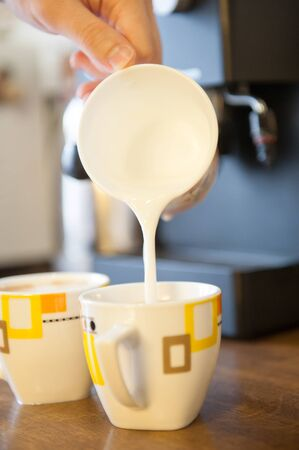 Whipping milk with espresso machine at home Stock Photo - 14565898