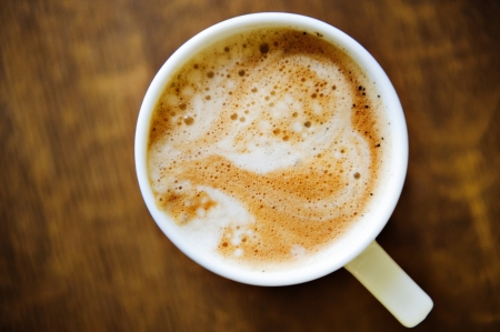 Heart shape on latte over wooden table Stock Photo - 14565273