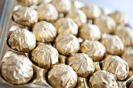 fine cane: Candy cane balls wrapped with golden foil Stock Photo