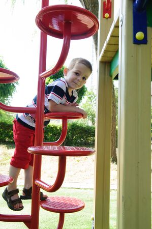 Little cute boy is climbing at playground Stock Photo - 14774683