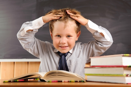 Cute elementary aged boy fooling at the lesson photo