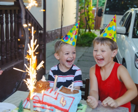 Outdoors birthday party with cake and fireworks candles photo