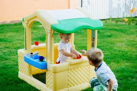 Children playing in toy house at playground Stock Photo - 15214075