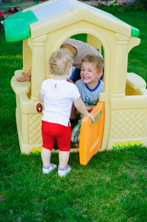 Children playing in toy house at playground Stock Photo - 15214085