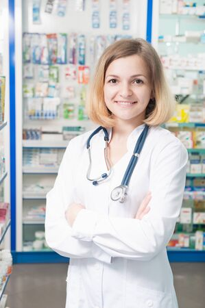 Young confident female doctor in pharmacy store photo