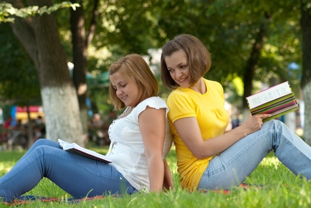 furtively: Two female students studying at campus park
