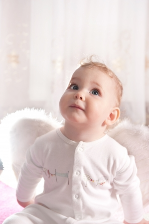 Cute little baby girl with angel wings photo