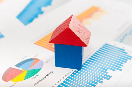 mortgage rates: Real estate market concept with graphs and house from toy blocks Stock Photo