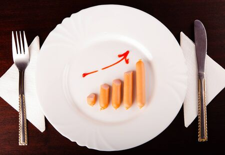 Food consumption growth trend via arranged sausages graph Stock Photo - 16303002