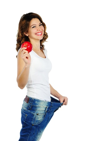 lose weight: Happy weight loss woman with red apple isolated on white background