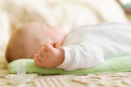 Cute newborn baby sleeping in bed. Shallow depth of field. Stock Photo - 17505804